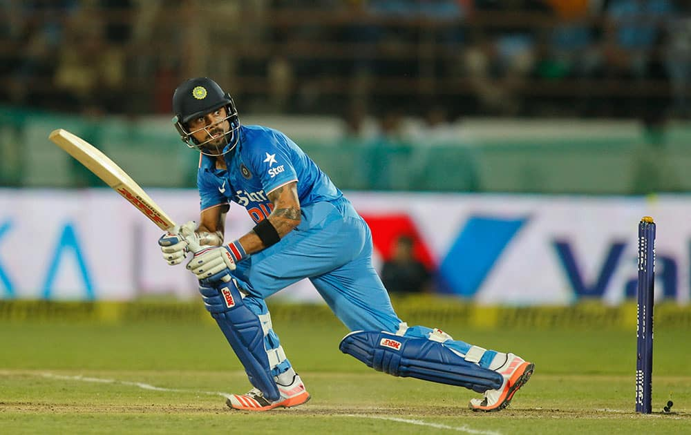 Virat Kohli watches his shot during their third one-day international cricket match against South Africa in Rajkot.