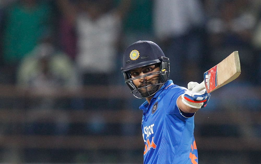Rohit Sharma acknowledges his fifty runs during their third one-day international cricket match against South Africa in Rajkot.