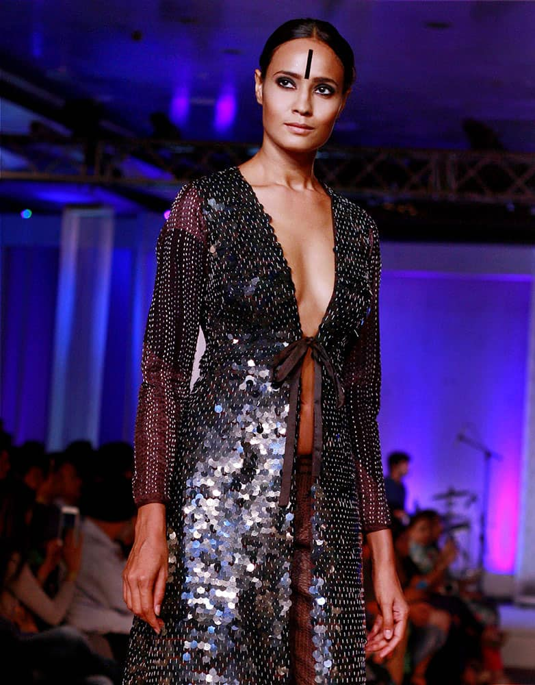 Model displaying a creation by designer Abraham & Thakore during the Blenders Pride Fashion Tour 2015 in Gurgaon.
