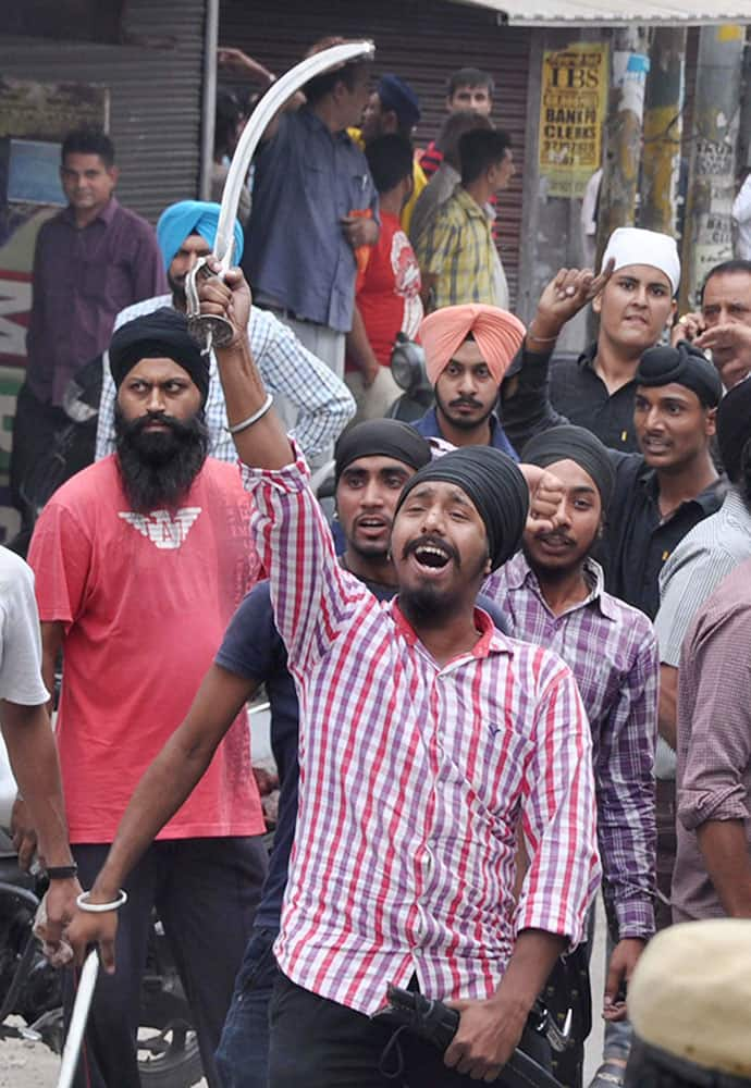 Sikh groups during protest against alleged discretion of religious book in Jalandhar.