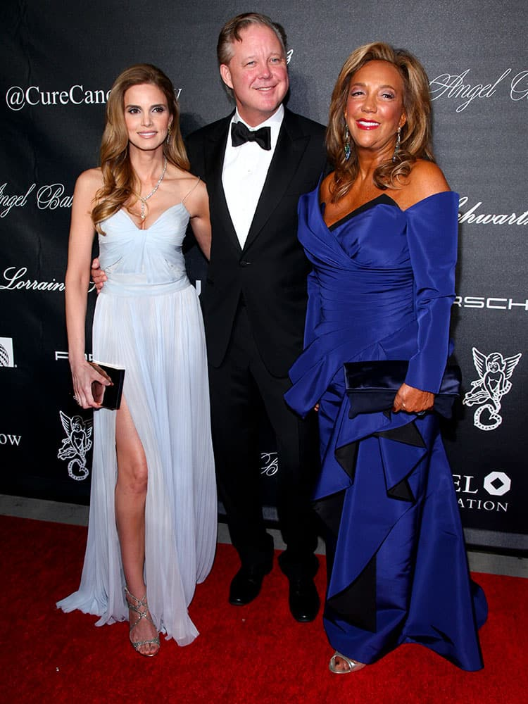 Amy France, from left, Brian France and Denise Rich arrive at Gabrielle's Angel Foundation for Cancer Research Angel Ball 2015 at Cipriani Wall Street in New York.