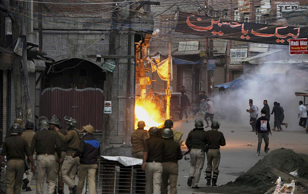 Police in action against JKLF supporters who were pelting stones during a clash in Srinagar.