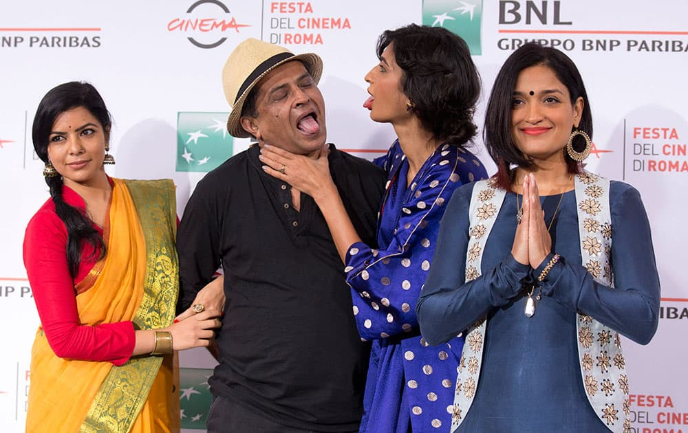 From left, actresses Rajshri Deshpande, director Pan Nalin, and actresses Anushka Manchanda and Sandhya Mridul pose for photographers during the photo call of the movie Angry Indian Goddesses at the Rome Film Festival in Rome.