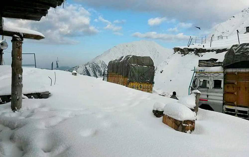 A view of snow covered Mughal Road after receiving seasons first snowfall in Peer Panchal range in Jammu and Kashmir.