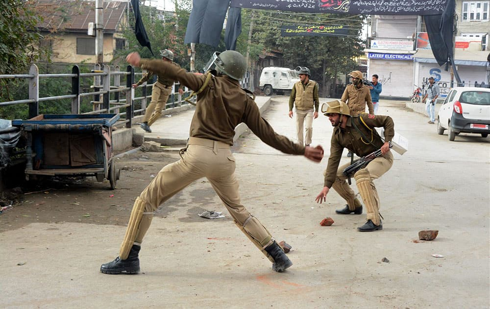 Security personnel in action to disperse JKLF supporters protesting against the arrest of their Chairman Yasin Malik in Anantang, at Business hub Lal Chowk in Srinagar.