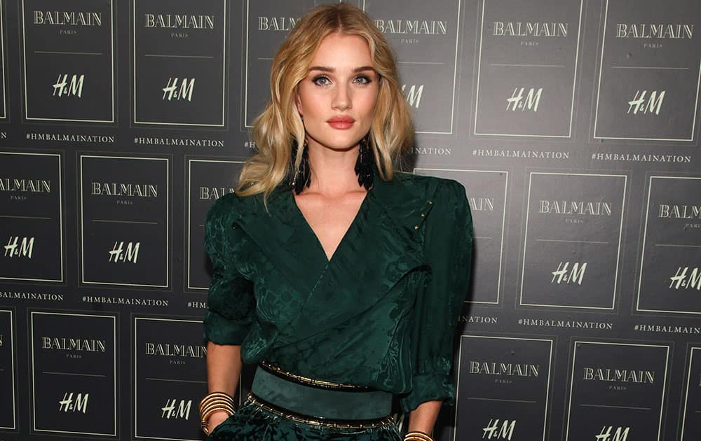 Rosie Huntington-Whiteley attends the Balmain x H&M Collection launch event at 23 Wall Street in New York.
