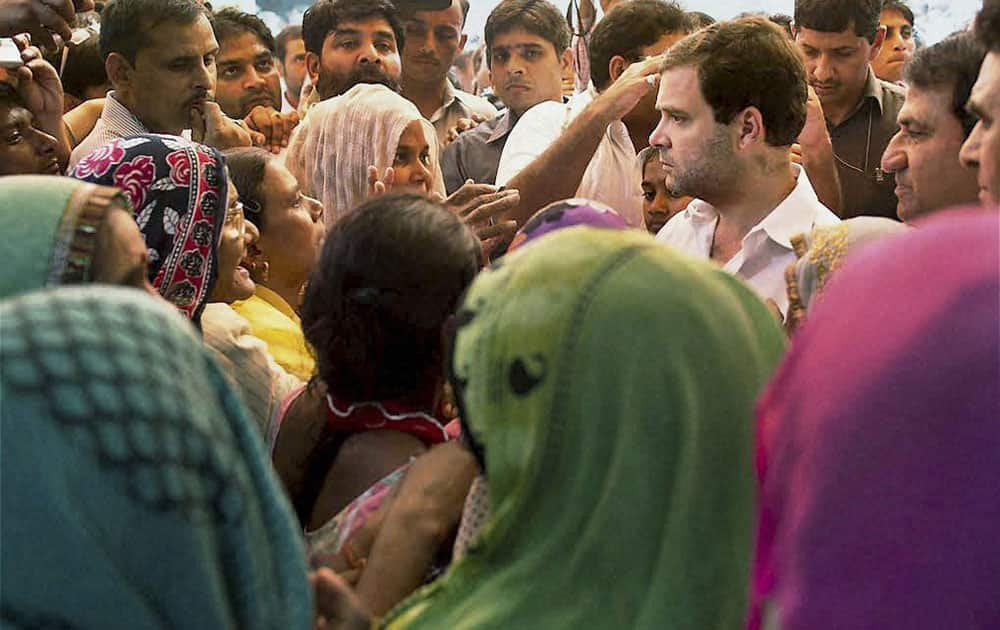 Congress Vice President Rahul Gandhi meeting people at Sunpedh village where a dalits house was set on fire allegedly by men belonging to the upper-caste community, in Ballabhgarh in Faridabad.