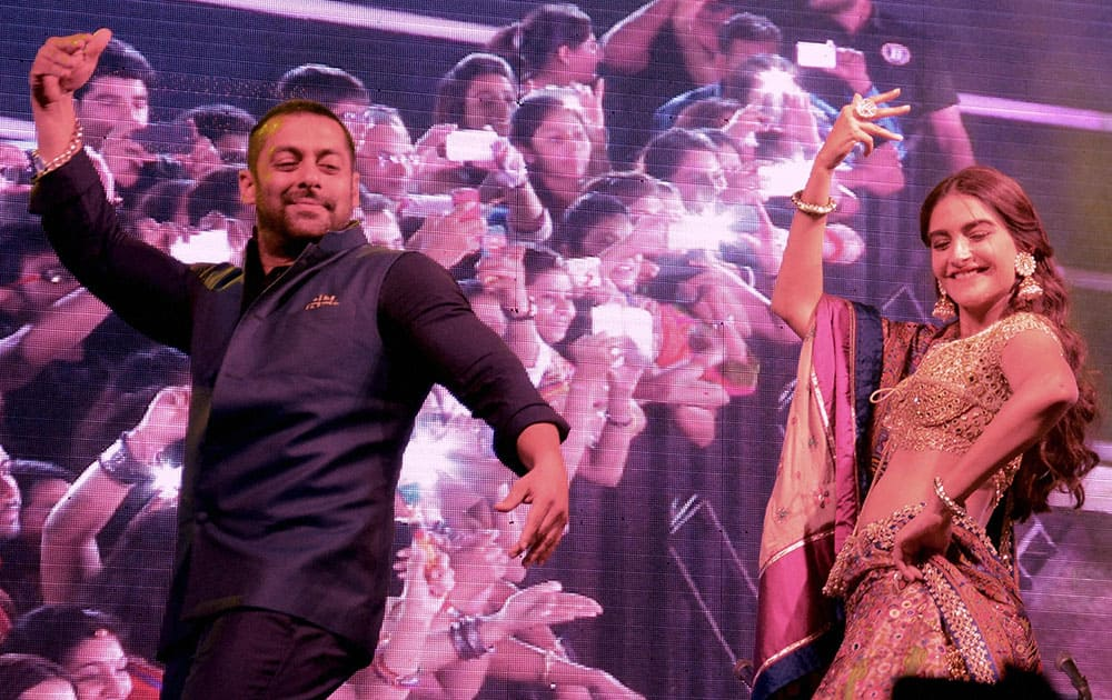 Actors Salman Khan with Sonam Kapoor at a Navratri festival in Ahmedabad.