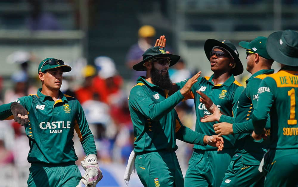 South Africans celebrates the wicket of India's Rohit Sharma during their fourth one-day international cricket match in Chennai