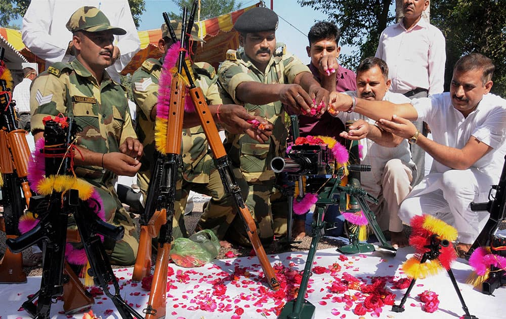 Border Security Force (BSF) soldiers perform Shastra Puja (worship of the weapons) on the occasion of Vijayadashmi at Khassa near Amritsar.