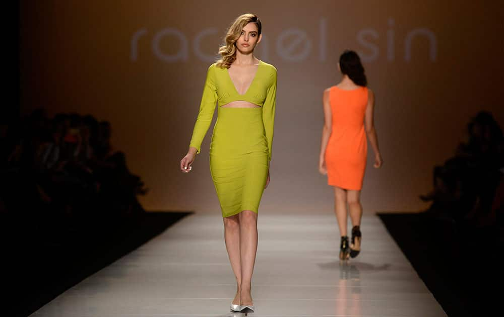 A model walks the runway in the Rachel Sin show, part of Fashion Week in Toronto.