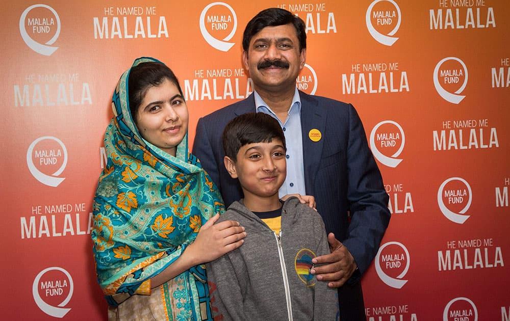 Malala Yousafzai, Atal Khan Yousafzai and Ziauddin Yousafzai pose for photographers upon arrival at the screening of the film He Named Me Malala in London.