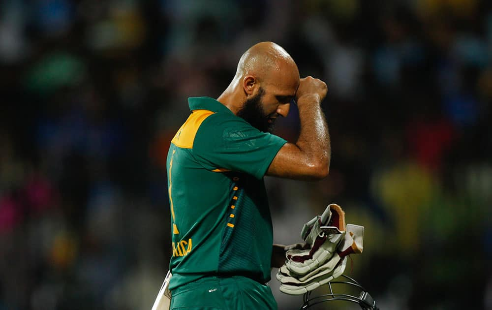 South Africa's Hashim Amla gestures as he walks back after his dismissal during their fourth one-day international cricket match against India in Chennai.