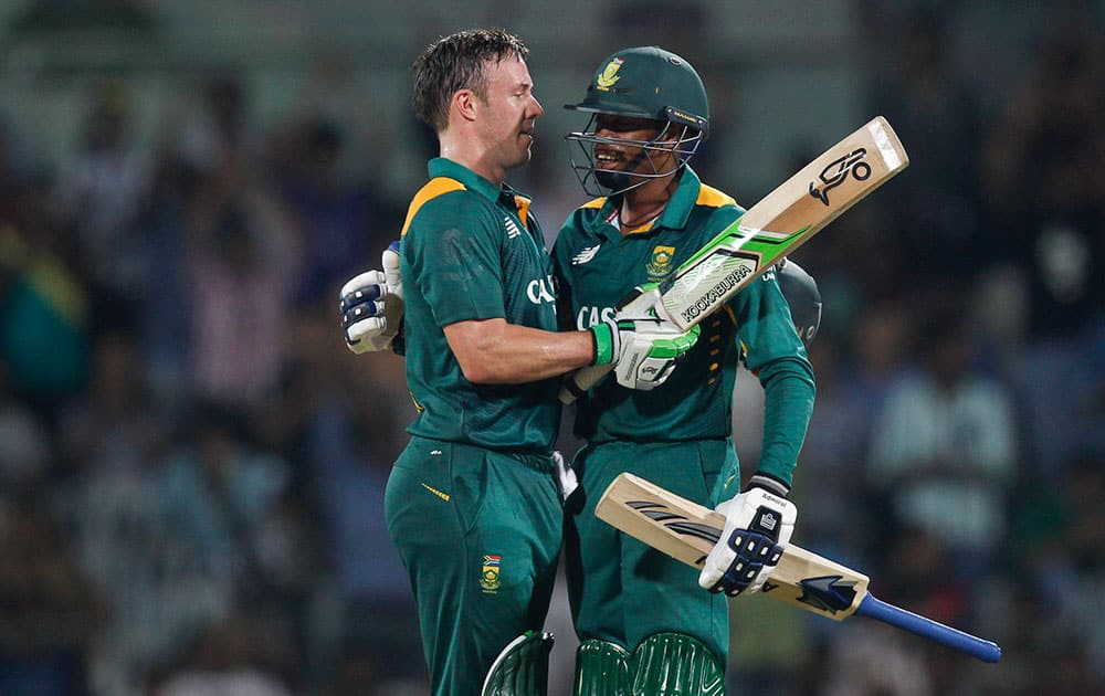 South Africa's captain A.B. de Villiers celebrates with Aaron Phangiso his hundred runs during their fourth one-day international cricket match against India in Chennai.