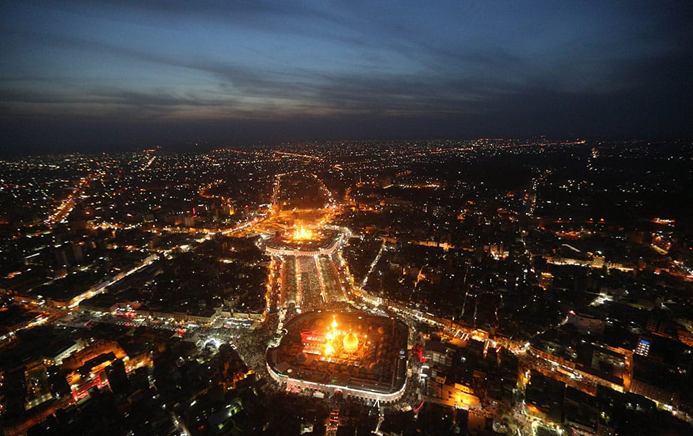 This aerial photo shows Shiite faithful pilgrims gather between, the holy shrine of Imam Hussein, top, and the holy shrine of Imam Abbas, bottom, during preparations for the Muslim holiday of Ashoura in the Shiite holy city of Karbala.