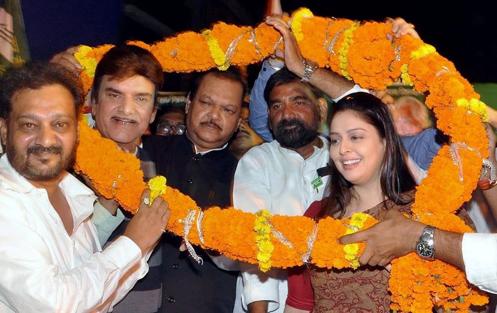 Bollywood actress and Congress leader Nagma garlanded during a public rally in Patna.
