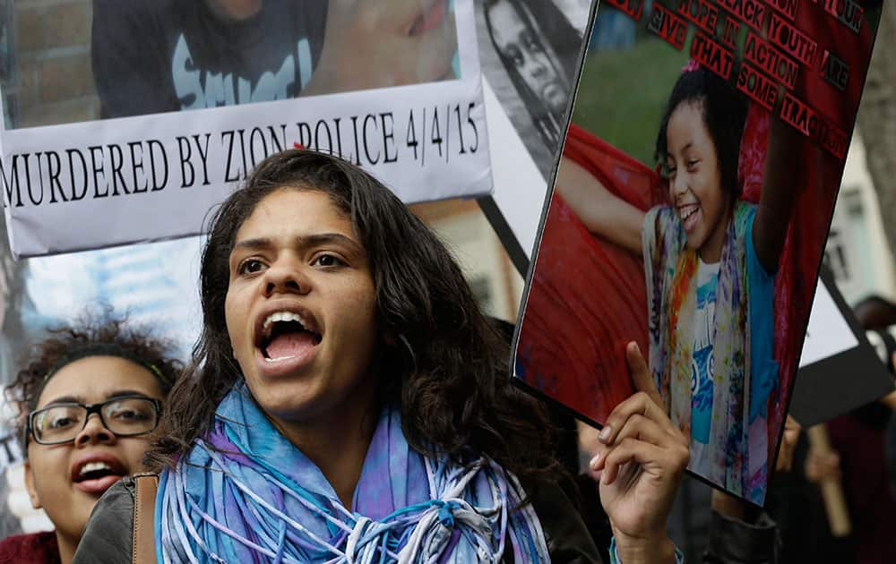Demonstrators chant slogans during a rally to protest against police brutality in New York. Speakers at the protest said they want to bring justice for those who were killed by police.