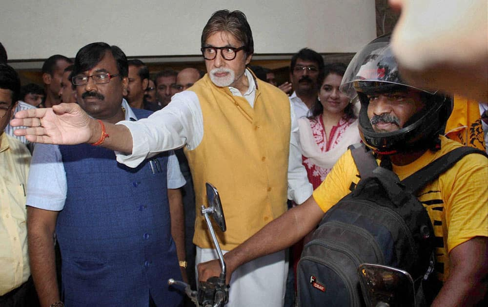 Bollywood actor Amitabh Bachchan and Sudhir Mungantiwar, Maharashtra minister of Finance and Planning, Forest Department during the flag off of Tiger Conservation Bike Rally, in Mumbai.