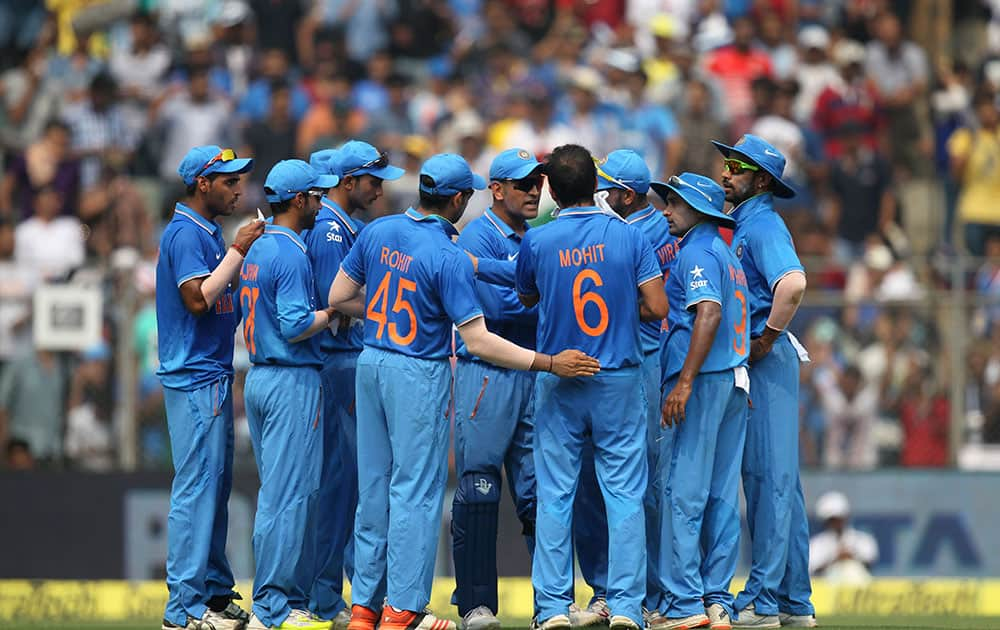 Indian players celebrate the dismissal of South Africa's Hashim Amla during the final one-day international cricket match of a five-game series in Mumbai, India.