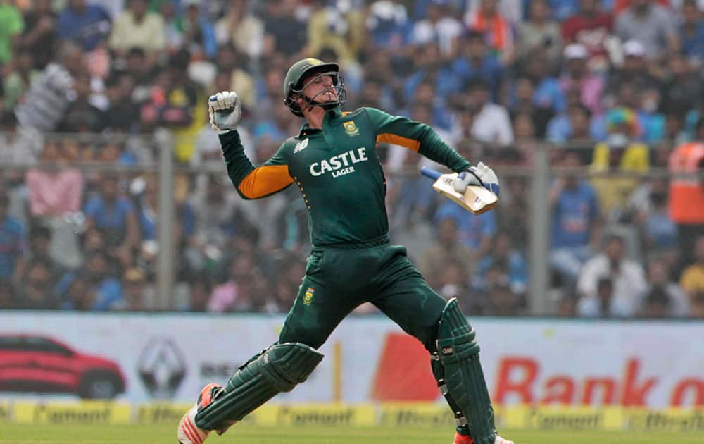 South Africa's Quinton de Kock celebrates his hundred runs during the final one-day international cricket match of a five-game series against India in Mumbai, India.