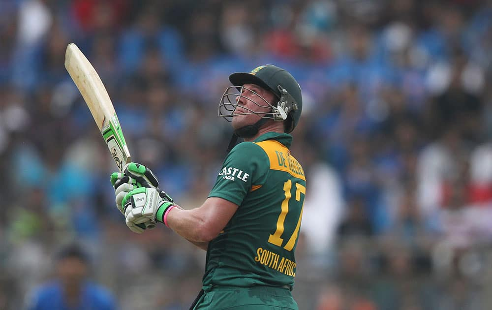 South Africa's A.B. de Villiers hits a six during the final one-day international cricket match of a five-game series against India in Mumbai, India.