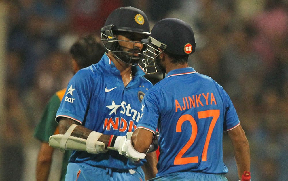 India's Ajinkya Rahane, right and Shikar Dhawan chat during the final one-day international cricket match of a five-game series against South Africa in Mumbai, India.