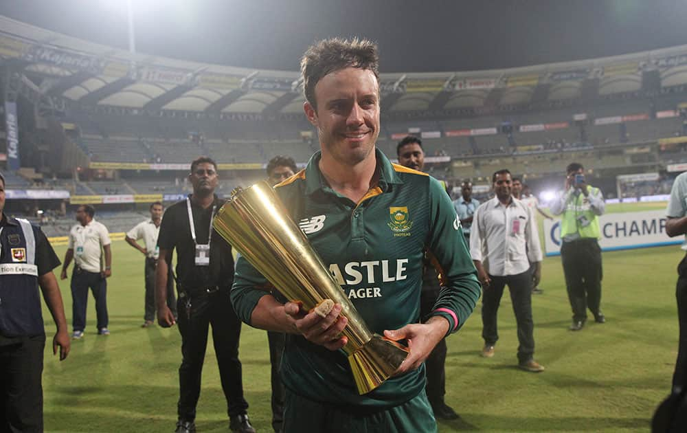 South African captain A.B. de Villiers, holds the series trophy after their victory against India in the final one-day international cricket match of a five-game series in Mumbai, India.