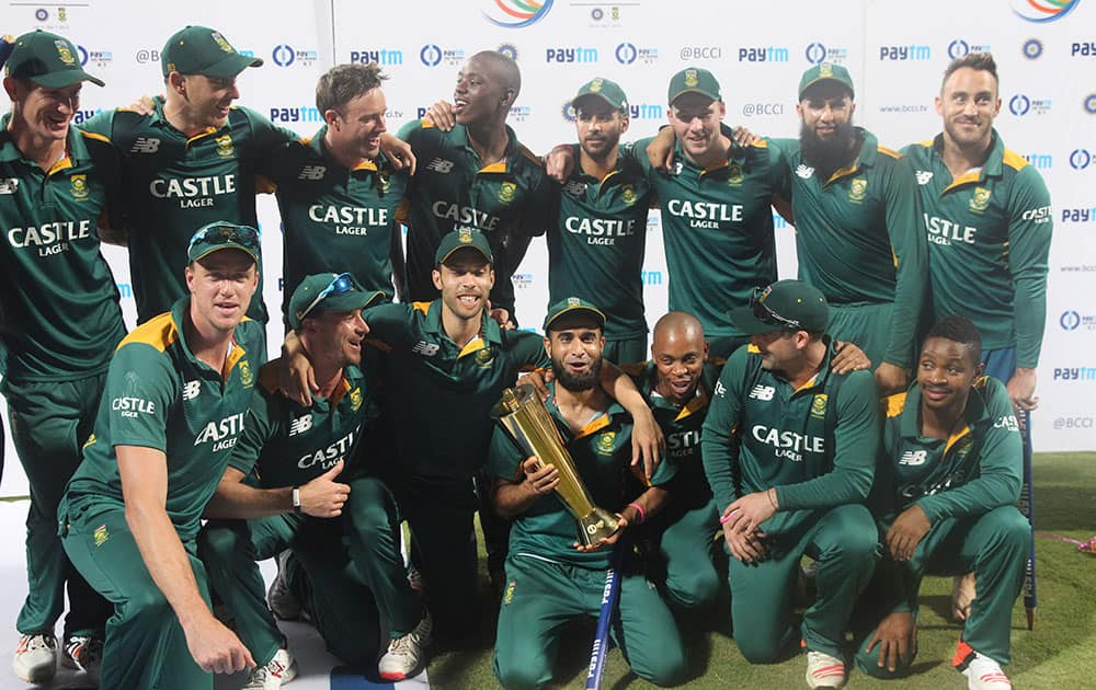 South African players pose with the series trophy after their victory against India in the final one-day international cricket match of a five-game series in Mumbai, India.