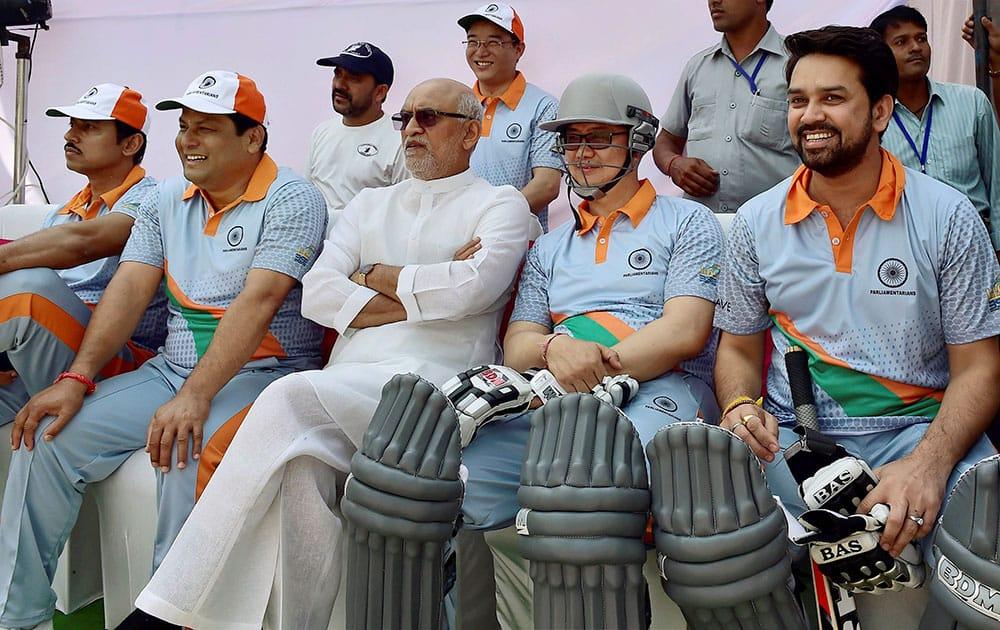 Parliamentarians Anurag Thakur, Kiren Rijiju, Satyavrat Chaturvedi, Sarbananda Sonowal and Rajyavardhan Rathore during a 20-20 cricket match between Parliamentarians and B Town Boys, in New Delhi.