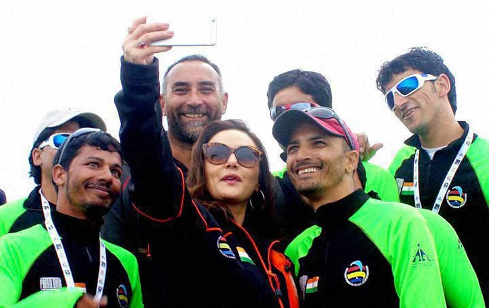 Actress Priety Zinta clicks selfie with the Indian team at the ongoing Paragliding World Cup at Bir Billing, Himachal Pradesh.