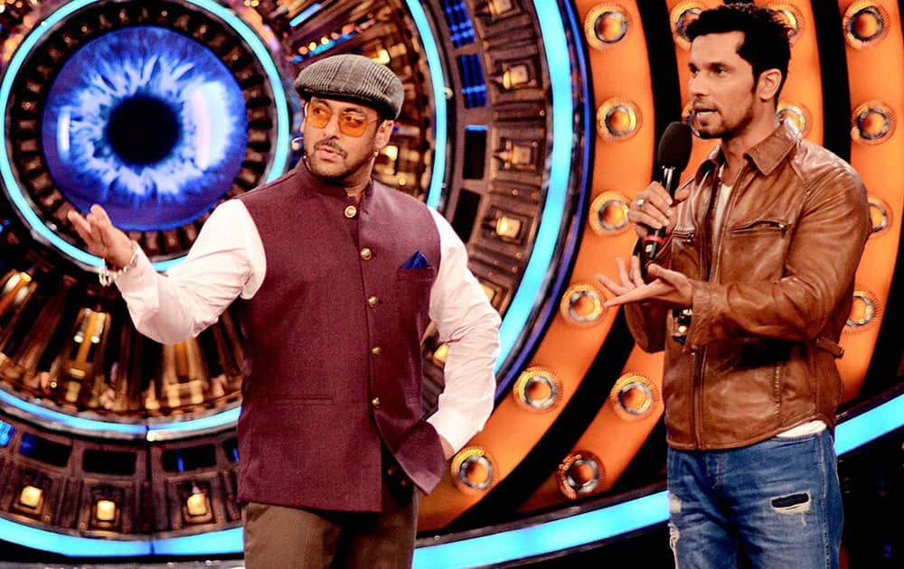 Bollywood actors Salman Khan with Randeep Hooda on the set of Bigg Boss in Mumbai.
