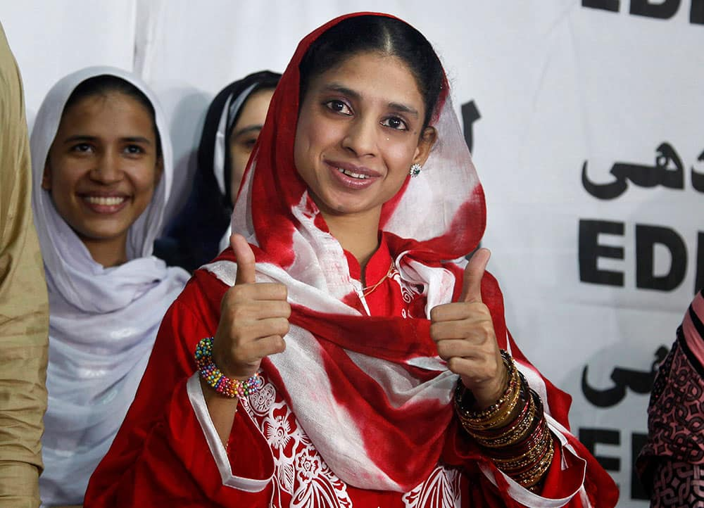 Indian national Geeta greets media with a traditional Indian
