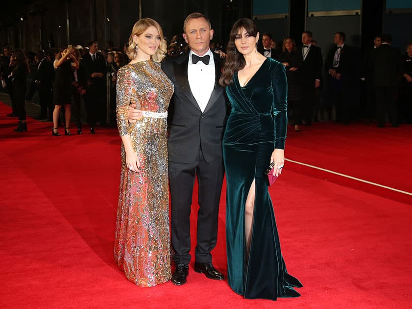 Lea Seydoux, from left, Daniel Craig and Monica Bellucci pose for photographers upon arrival for the World Premiere of 'Spectre' at the Royal Albert Hall in central London.