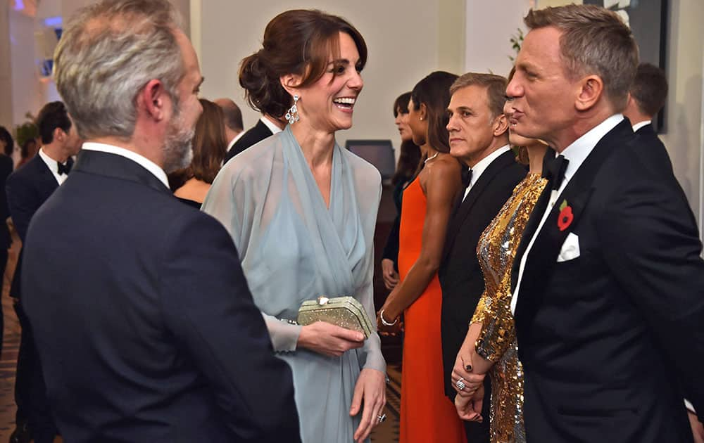 Kate, the Duchess of Cambridge, meets actor Daniel Craig with director Sam Mendes at left, during the World Premiere of the new James Bond film Spectre, in London.