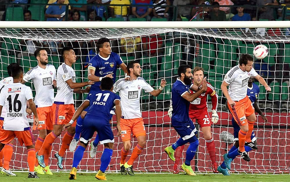 Chennaiyan FC and FC Pune City players vie for the ball during the Indian Super League (ISL) match at Jawaharlal Nehru Stadium in Chennai.