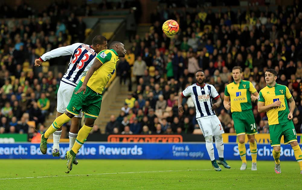 West Bromwich Albion's Salomon Rondon, left heads the ball to score, during the EnglishLeague soccer match between Norwich City and West Bromwich Albion, at Carrow Road, in Norwich, England.
