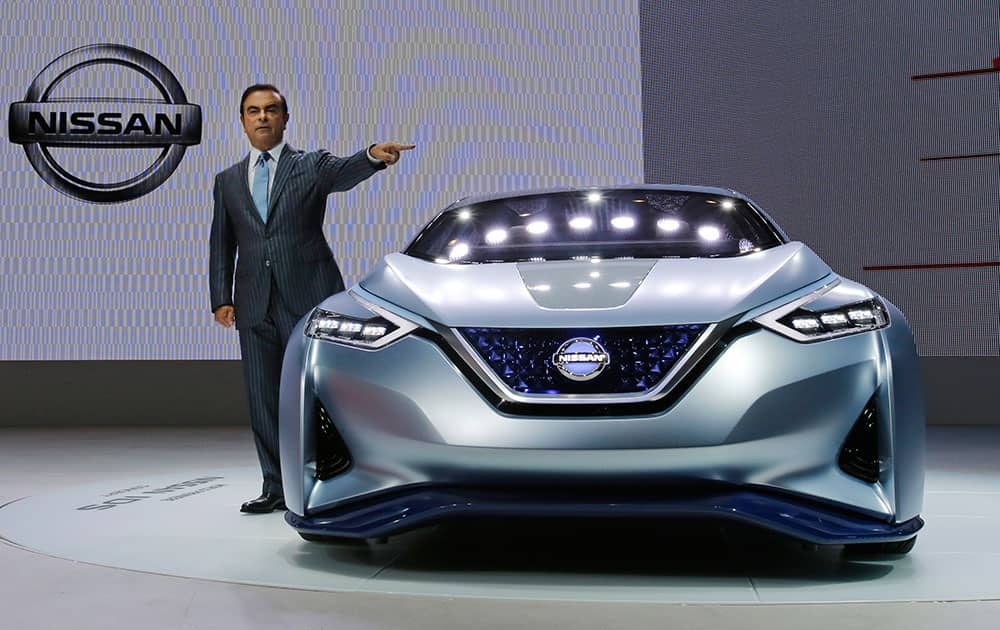 Carlos Ghosn, president and CEO of Nissan Motor Co., unveils the Nissan IDS Concept vehicle, which features self-driving and zero emission, in the media preview for the Tokyo Motor Show in Tokyo.