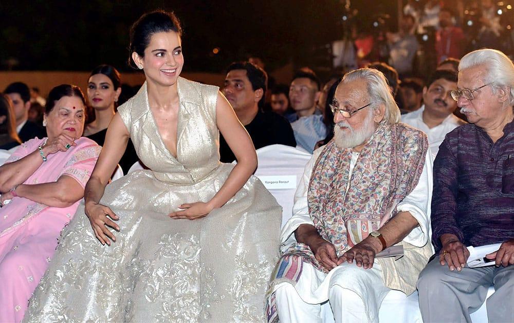 Industrialist Mukesh Ambanis mother Kokilaben Ambani, actress Kangana Ranaut, film maker Adoor Gopalakrishnan during the opening ceremony of 17th edition of Jio MAMI Mumbai Film Festival, in Mumbai.