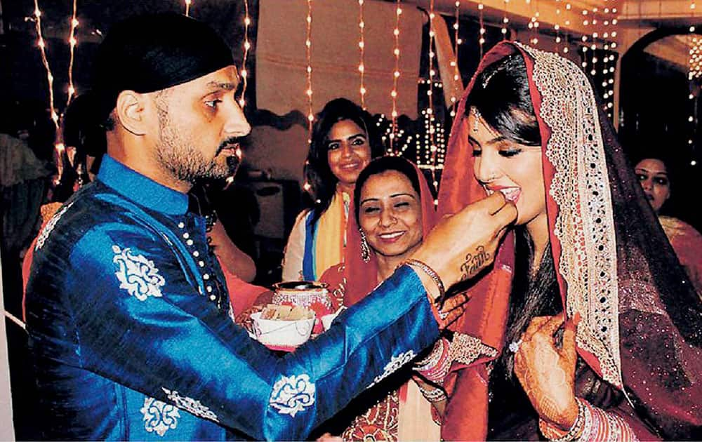 Cricketer Harbajan Singh along with his wife during Karva Chauth celebrations, in Jalandhar.