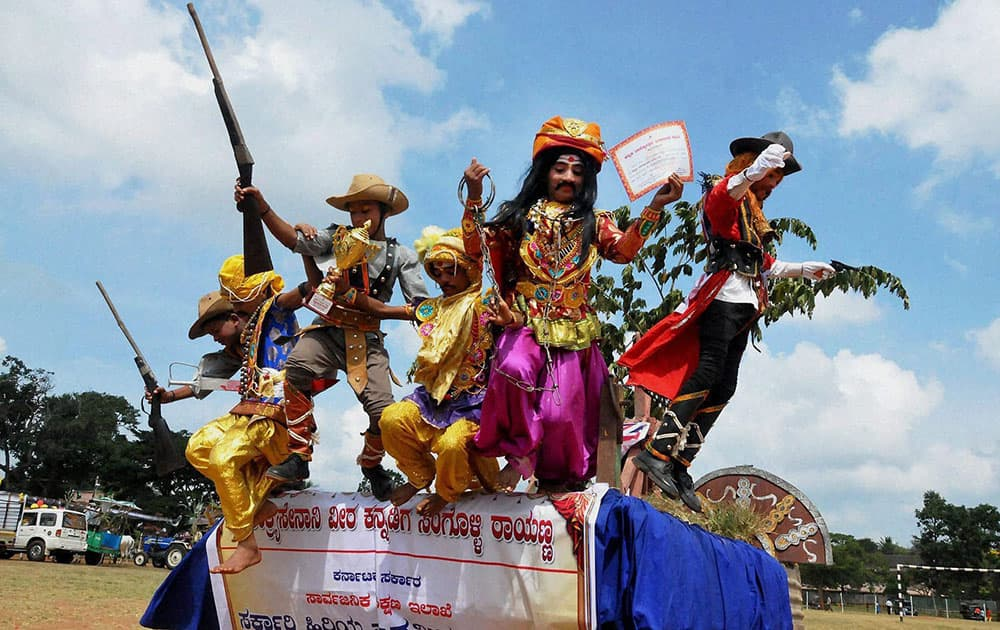 Children cheering after recieving prize for their tableau at the 60th Kannada Rajyotsava Celebrations in Chikmagalur.