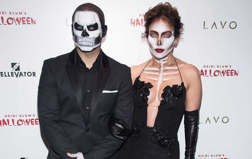 Jennifer Lopez, right, and Casper Smart attend Heidi Klum's 16th annual Halloween party, at Lavo.