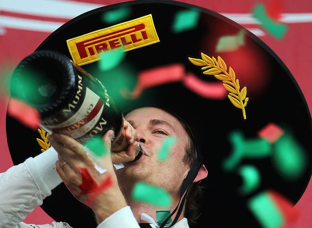 Mercedes driver Nico Rosberg of Germany celebrates on the podium after the Formula One Mexico Grand Prix auto race at the Hermanos Rodriguez racetrack in Mexico City.