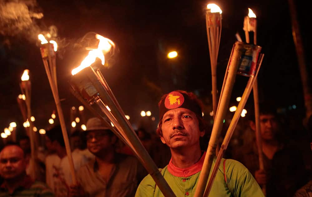 Bangladeshi activists, writers and publishers participate in a torch rally held to protest against the killing of Faisal Arefin Deepan, a publisher of secular books, and the attacks on the other publishers and bloggers in Dhaka, Bangladesh.