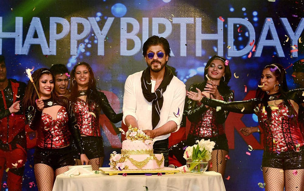 Shahrukh Khan cuts a cake during his birthday celebrations at a hotel in Mumbai.