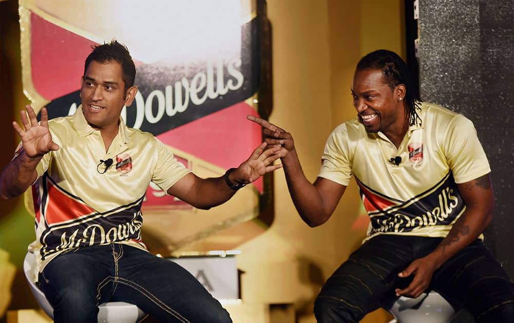 Indian Skipper M S Dhoni and West Indies cricketer Chris Gayle at a promotional event of Mcdowells No.1 Soda in New Delhi.