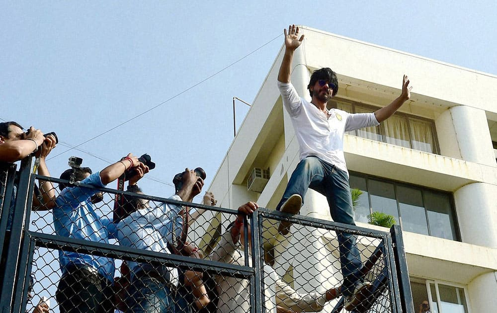 Bollywood actor Shahrukh Khan addresses his fans on his 50th birthday celebration outside his residence, Mannat in Mumbai.