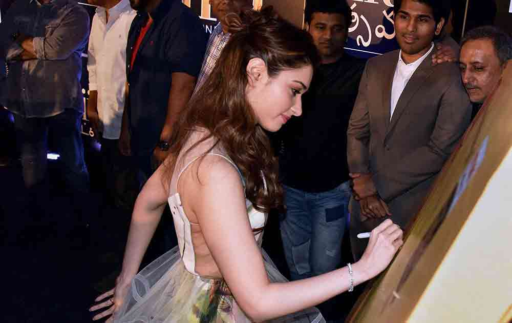 Actress Tamanna Bhatia signs during the launch of The International Indian Film Academy Awards (IIFA) in Hyderabad.
