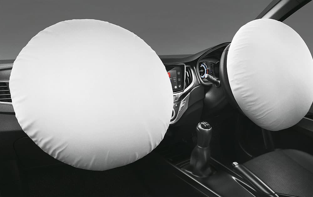 Dual front airbags mitigate collision forces in the event of a frontal impact.
