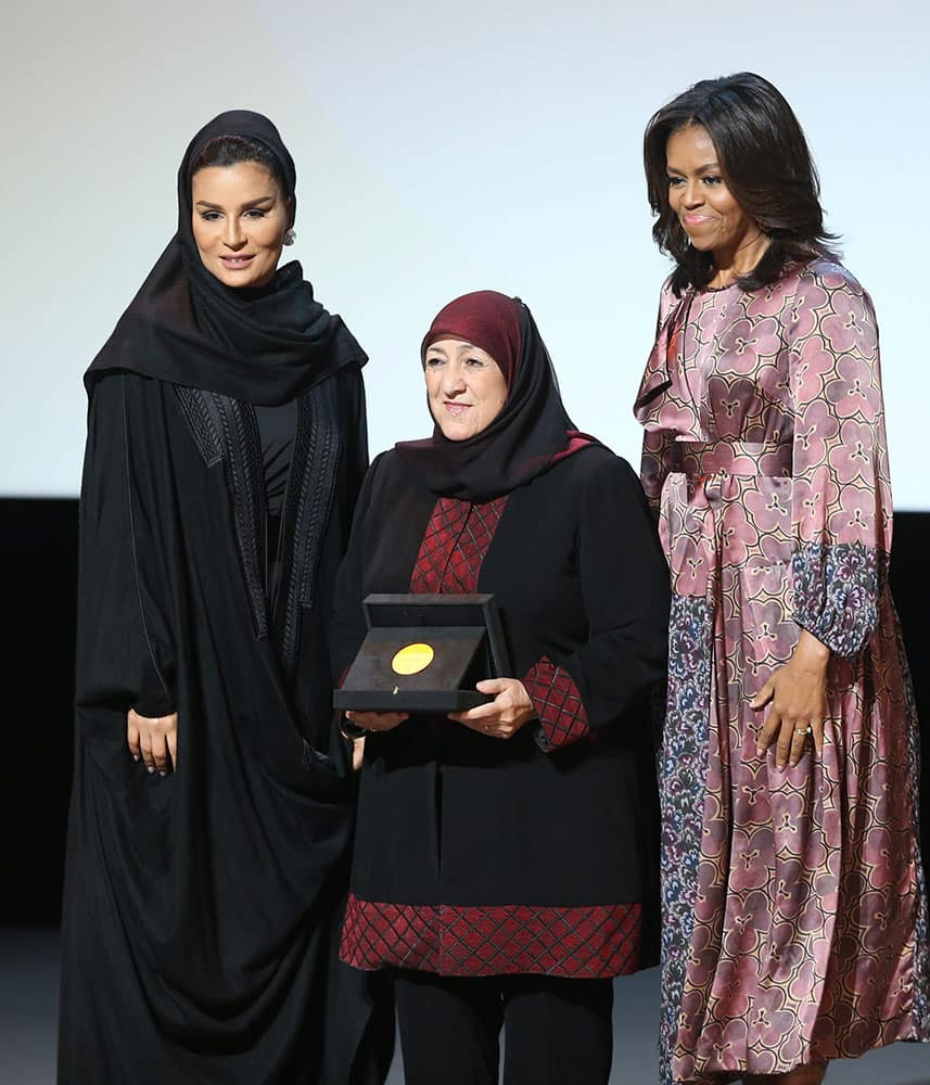 Sheikha Mozah, left and and U.S. first lady Michelle Obama, right, award the 2015 WISE Prize for Education to Sakena Yacoobi, the founder and CEO of the Afghan Institute of Learning, center, Yacoobi received a gold medal and $500,000, during the 2015 World Innovation Summit for Education (WISE) held at the convention center in Doha, Qatar.