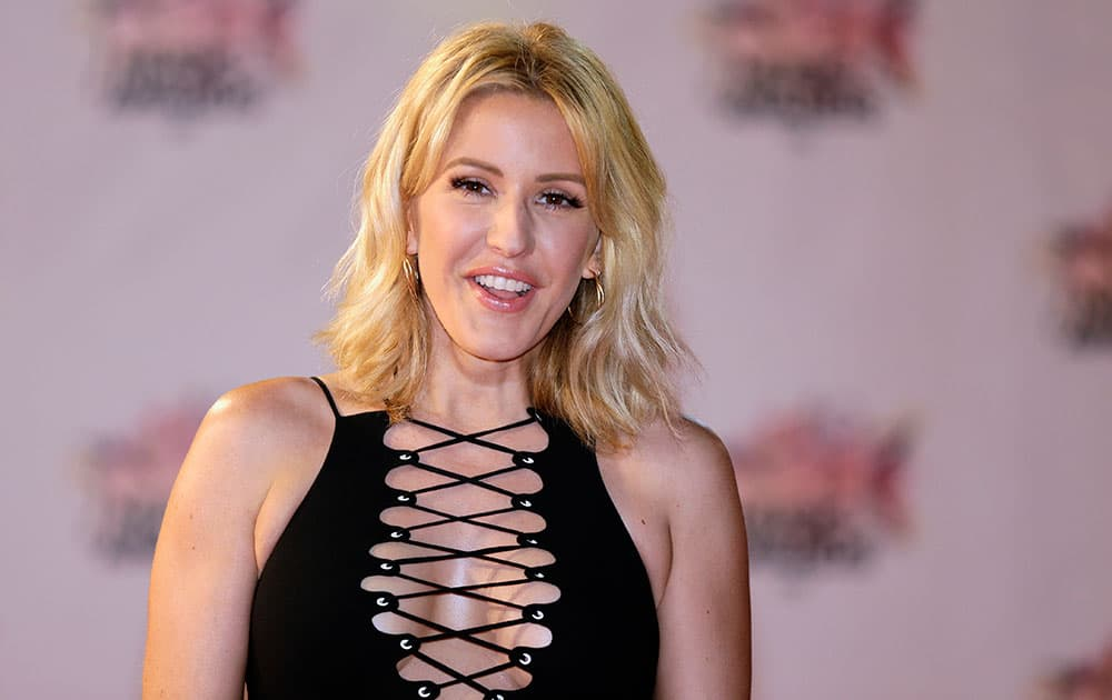 British singer Ellie Goulding arrives at the Cannes festival palace, to take part in the NRJ Music awards ceremony in Cannes, southeastern France.